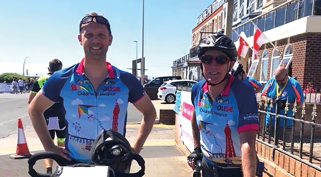 Trinity's HR Manager David Warburton with Dave Young after completing the Manchester to Blackpool Bike Ride.