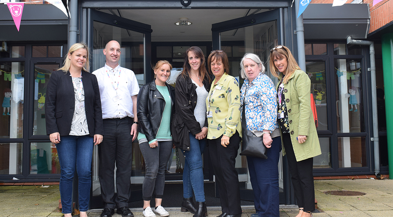 Some of the delegates and speakers at the Too Little Too Late research conference take a tour around Brian House Children's Hospice, led by clinical manager Carol Wylde (third right).