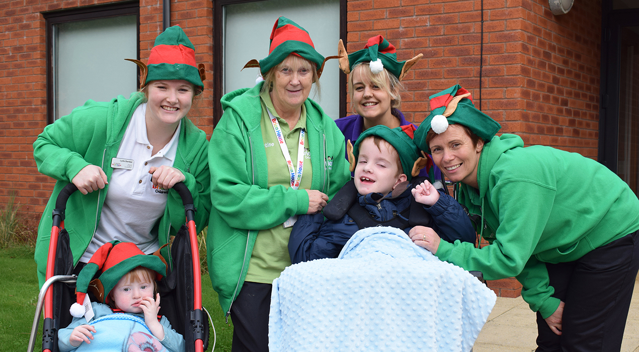 Elizabeth Welsh, three, and Jack Caton, 10, are looking forward to the charity's Elf Run with staff at Brian House Children's Hospice.