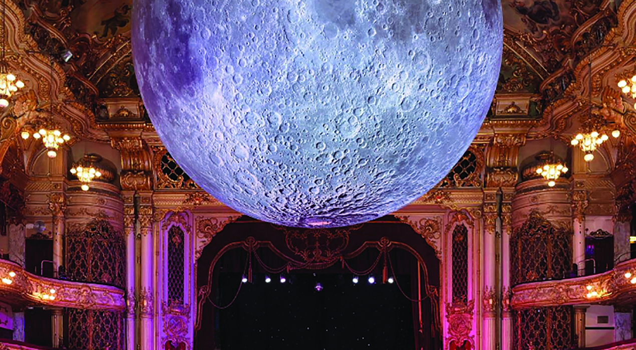 The Moon in the Tower Ballroom, adorns the cover of the 2019 resort guide